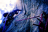 "A rock climber leading a pitch on ""The Zodiac"", El Capitan,  Yosemite National Park, California.  ""The Zodiac"" is an extremely challenging that takes average climbing teams three days to ascend.  Teams must camp on the side of the cliff to complete the climb successfully."