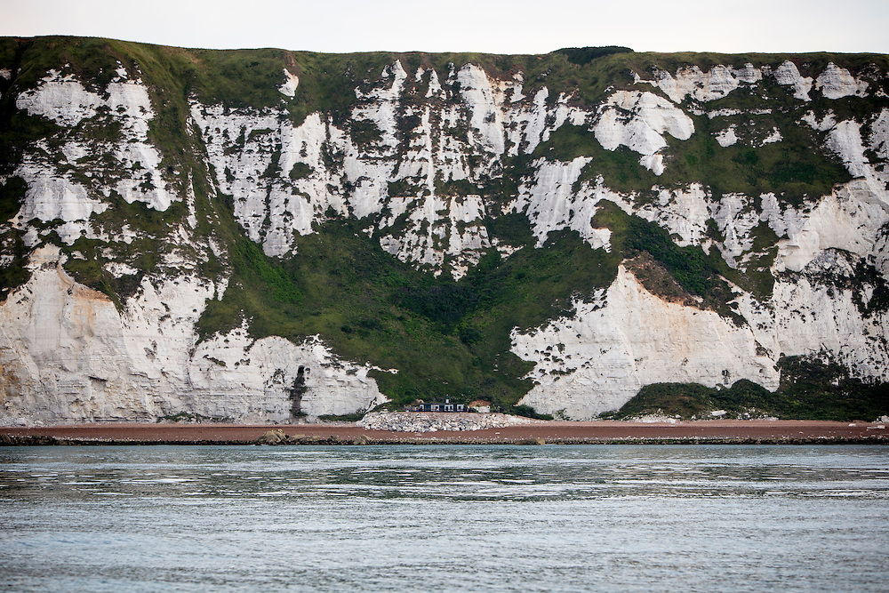 The famous chalky White Cliffs of Dover above The Warren Beach and country park a secluded building sits at the bottom of the cliff on a rock platform on the beach, Folkestone, Kent, England, United Kingdom.  (photo by Andrew Aitchison / In pictures via Getty Images)