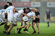 Gareth Thomas and Kieran Williams of the Ospreys tackle Jack Willis of Wasps during the Anglo Welsh Cup match between Ospreys and Wasps at The Liberty Stadium, Swansea, Wales on 10 November 2017. Photo by Andrew Lewis.