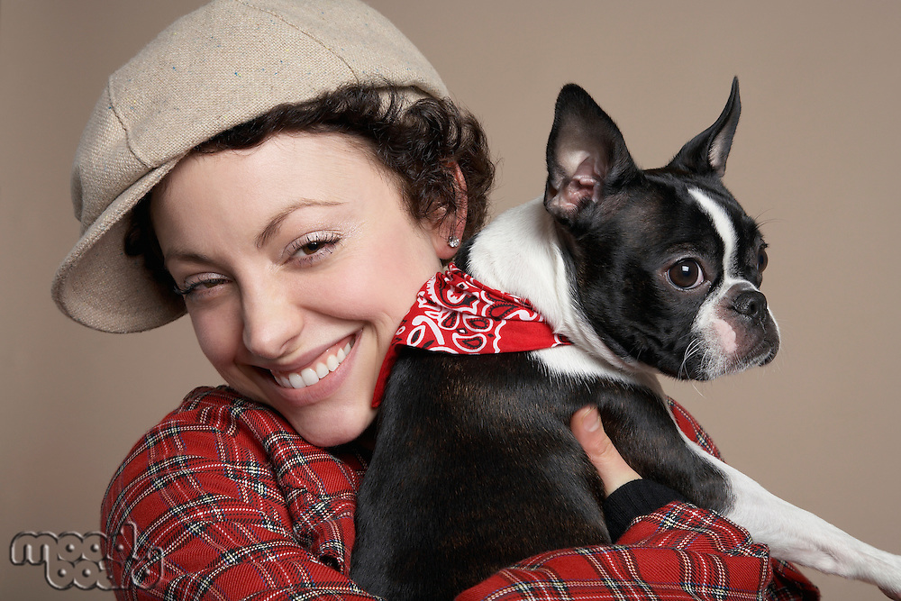 Young woman holding French Bulldog close-up
