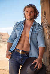hot cowboy with an open shirt with great abs