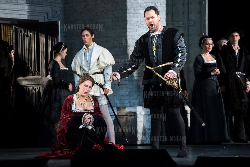 September 23, 2015 - New York, NY : From left, Sondra Radvanovsky (as Anna Bolena -- in red), Tamara Mumford (as Mark Smeaton -- in white), and Ildar Abdrazakov (as Henry VIII -- with sword), perform in a dress rehearsal for Gaetano Donizetti's 'Anne Bolena' at the Metropolitan Opera at Lincoln Center on Wednesday. CREDIT: Karsten Moran for The New York Times