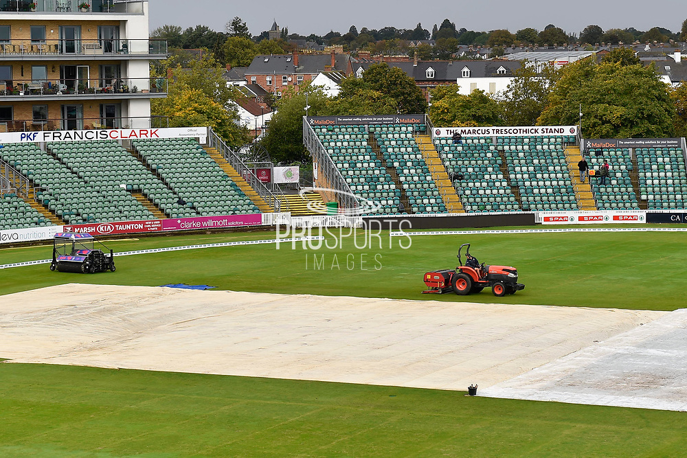 The covers are on and a groundsman is verti-draining the outfield after more heavy overnight rain ahead of the Specsavers County Champ Div 1 match between Somerset County Cricket Club and Essex County Cricket Club at the Cooper Associates County Ground, Taunton, United Kingdom on 25 September 2019.