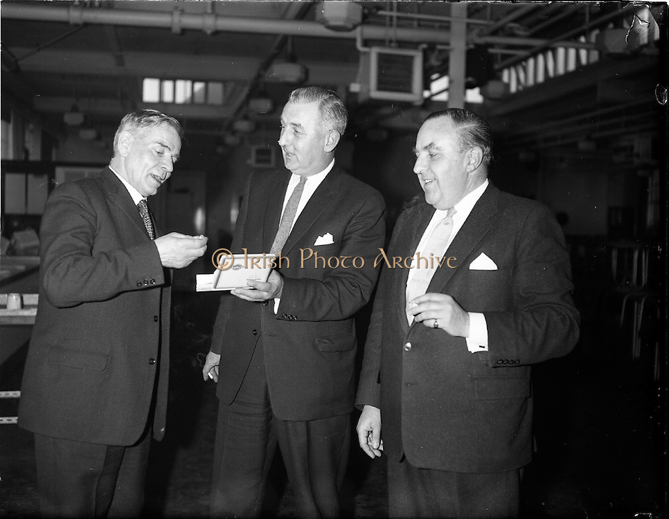 "26/01/1962<br /> 01/26/1962<br /> 26 January 1962<br /> Crew members of the British Railways vessel ""Cambria"" touring W.D. and H.O. Wills factory, Dublin. (l-r): Mr. Ben Parry, Acting Catering Superintendent, British Railways, Marine, Holyhead; Mr T.W.W. Irvine, Factory Manager and Mr. E.A. Williams, Wills Representative in Dublin."