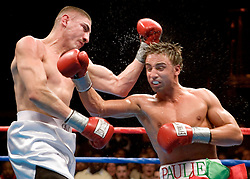 February 10, 2006 - Mashantucket, CT - Junior Welterweights Paulie Malignaggi (r) and Donald Camarena (l) trade punches during their 10 round junior welterweight bout at the Fox Arena in the Foxwoods Hotel & Casino.  Malignaggi remained undefeated with a unanimous decision win.