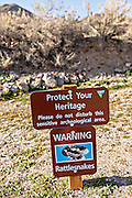 Sign warning of rattlesnakes in Rhyolite, NV.