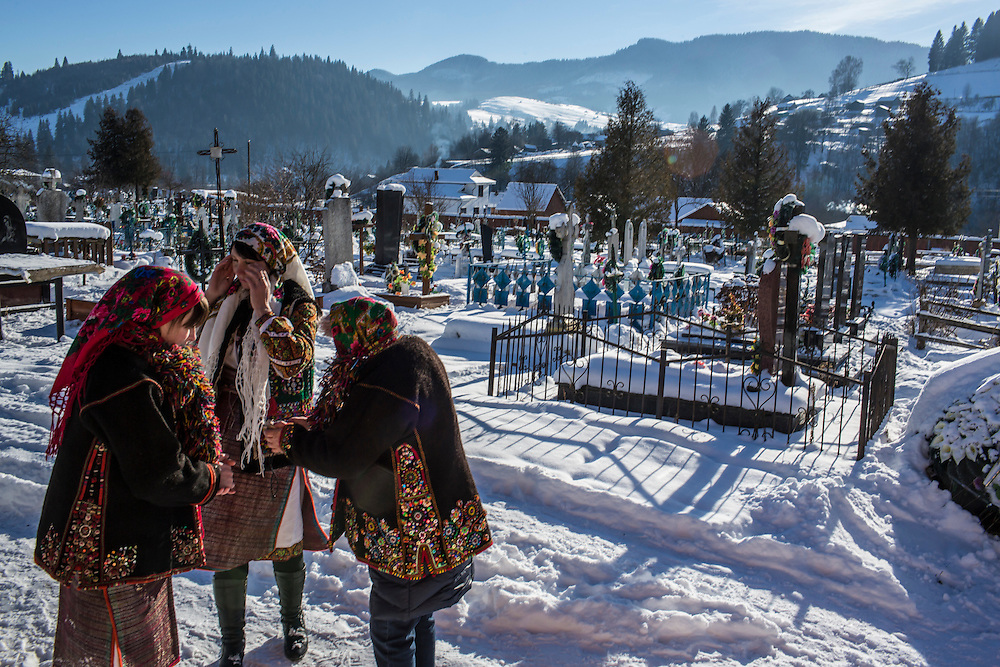 ILTSI, UKRAINE - JANUARY 7: Women wearing traditional Hutsul clothing gather at Holy Trinity Church to celebrate the Orthodox Christmas on January 7, 2015 in Iltsi, Ukraine. The men will gather in groups and travel house to house over the next twelve days singing songs until they've visited every home in the village. (Photo by Brendan Hoffman/Getty Images) *** Local Caption ***
