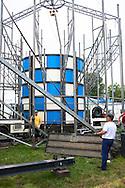 DEU, Germany, Duesseldorf, fun fair at the banks of the river Rhine in the town district Oberkassel, dismounting of the ride Rotor [the Rotor is a large rotating drum where the visitors are standing with their backs to the wall. When the rotation of the drum is fast enough the floor drives down. By the centrifugal force the visitor cleaves at the wall, the centrifugal force defeats the gravitation force].<br /> <br /> DEU, Deutschland, Duesseldorf, Kirmes auf den Rheinwiesen im Stadtteil Oberkassel, Abbau des Fahrgeschaefts Rotor der Schaustellerfamilie Pluschies [der Rotor ist eine grosse sich drehende Trommel, bei der der Besucher sich mit dem Ruecken zur Wand stellt. Dreht sich die Trommel schnell genug, wird der Boden nach unten gefahren. Der Besucher klebt durch die Fliehkraft an der Wand, die Fliehkraft siegt ueber die Schwerkraft] .