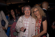 BILL WYMAN; SUZANNE WYMAN, The Summer party 2011 co-hosted by Burberry. The Summer pavilion designed by Peter Zumthor. Serpentine Gallery. Kensington Gardens. London. 28 June 2011. <br /> <br />  , -DO NOT ARCHIVE-© Copyright Photograph by Dafydd Jones. 248 Clapham Rd. London SW9 0PZ. Tel 0207 820 0771. www.dafjones.com.