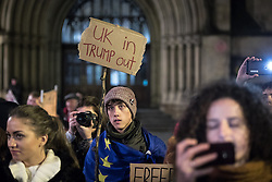 """© Licensed to London News Pictures . 20/02/2017 . Manchester , UK . Man with a home made """" UK in Trump out """" placard . Hundreds of protesters at a Stop Trump demonstration in Albert Square , central Manchester , to coincide with Parliament debating a petition calling for the government to cancel a State Visit by US President Donald Trump . Photo credit: Joel Goodman/LNP"""