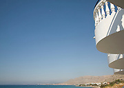 Coastal view with white balcony blue sky, Pefkos, Rhodes, Greece
