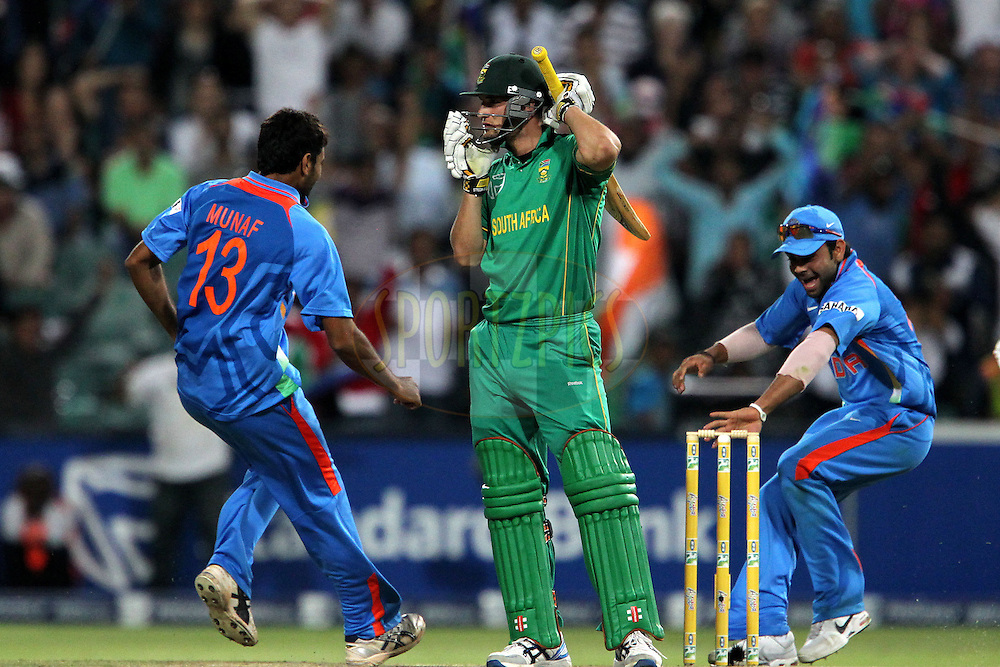 Munaf Patel of India and Rohit Sharma of India grab a stump whilst Wayne Parnell of South Africa is devastated at losing his wicket during the 2nd ODI between South Africa and India held at Wanderers Stadium in Johannesburg, South Africa on the 15th January 2011..Photo by Ron Gaunt/BCCI/SPORTZPICS