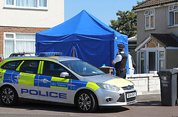 © Licensed to London News Pictures. 03/08/2018. London UK: Police officers at a fire damaged house in Rush Green, east London, where a body of a woman was found. A 50-year-old man was arrested at the scene on suspicion of murder and currently remains in custody at an east London police station.. Photo credit: Steve Poston/LNP