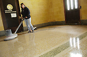 Sheri Beyler of North Shore Marble buffs the new terrazzo floor in the vestabule of the National Shrine of Mary, Help of Christians, on March 24. (Catholic Herald photo by Sam Lucero)