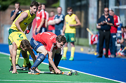 England's Alastair Brogdon is challenged by Liam De Young of Australia. England v Australia, Bisham Abbey, Marlow, UK on 25 May 2014. Photo: Simon Parker