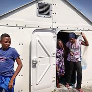 """La casetta di Ikea """"Better Shelter"""", pensata per accogliere i rifugiati.  nel centro polifunzionale 'Teobaldo Fenoglio' di Settimo Torinese, diventato un punto di riferimento per tutto il Paese nel campo dell'accoglienza, delle emergenze, della formazione, delle attività socio-assistenziali."""