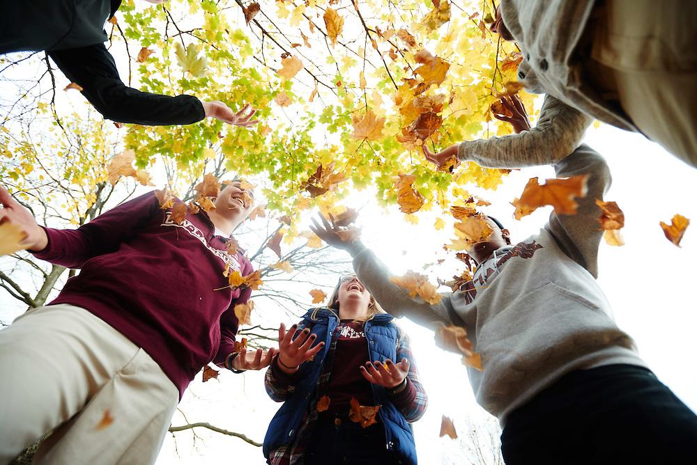 -UWL UW-L UW-La Crosse University of Wisconsin-La Crosse; cloudy; day; Diversity; Fall; Group; Lifestyle; Man men; November; Outside; Smiling; Socializing; Student students; Vanguards; Wing; Woman women, Tree; Leaves;  Leaf