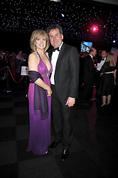 TV presenter RICHARD KEYS and his wife JULIA at The Butterfly Ball in aid of the Caudwell Children Charity held in Battersea park, London on 14th May 2009.