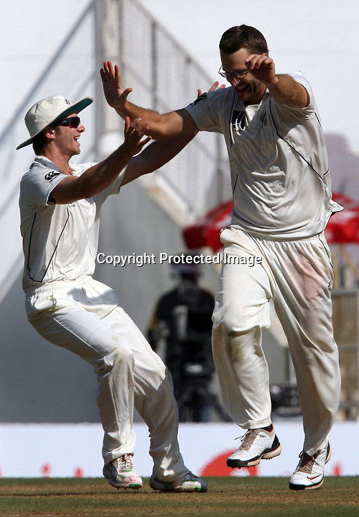 New Zealand bowler Daniel Vettori celebrates with kane Williamson Indian batsman Suresh Raina wicket during the 3rd test match India vs New Zealand day-3 Played at Vidarbha Cricket Association Stadium, Jamtha, Nagpur, 22, November 2010 (5-day match)
