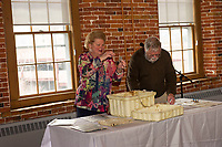 Opening up of the 25 year time capsule at Laconia City Hall.  Karen Bobotas for the Laconia Daily Sun