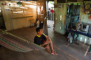A young adult community member practices playing the flute - Communidad Siete de Augosto - Amazonas - Colombia