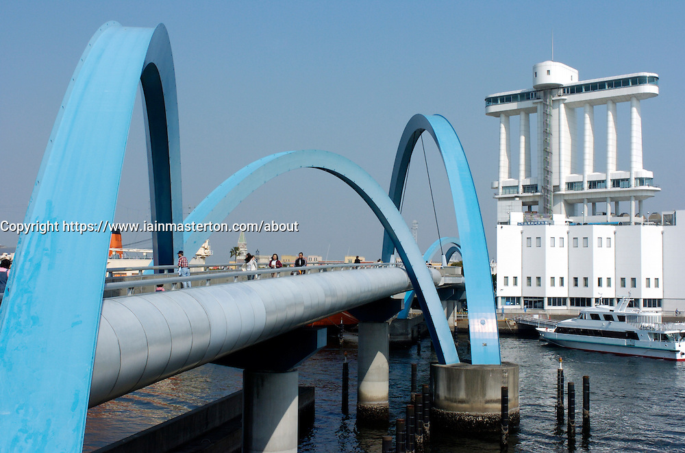 Blue steel footbridge with curving arches at port of Nagoya in Japan