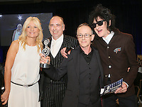 (L-R) Gabby Roslin, MIck Jones, Nick Headon, John Cooper Clark. The Silver Clef Lunch 2013 in aid of  Nordoff Robbins held at the London Hilton, Park Lane, London.<br /> Friday, June 28, 2013 (Photo/John Marshall JME)