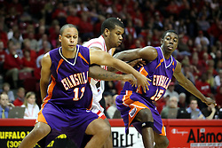 12 January 2008: Brandon Sampay gets doubled on by Victor Gomez and Jay Couisnard after a foul shot during a game in which  the Purple Aces of the University of Evansville lost to  the Redbirds of Illinois State on Doug Collins Court at Redbird Arena in Normal Illinois by a score of 74-66.