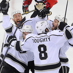 May 30, 2012: Los Angeles Kings center Colin Fraser (24) celebrates his goal with line mates during first period action in game 1 of the NHL Stanley Cup Final between the New Jersey Devils and the Los Angeles Kings at the Prudential Center in Newark, N.J.
