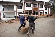 Men at work building new tourist centre at Dazu Rock Carvings, Mount Baoding, Chongqing, China