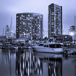 Photo of Embarcadero Marina at Night in San Diego California with luxury yachts and downtown San Diego buildings. Photo is high resolution and was taken in 2012.