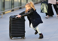 An excited youngster rushing to check in at London Gatwick airport as the Christmas getaway starts Friday, 20th December 2013. Picture by Stephen Lock / i-Images