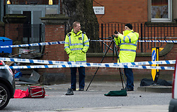 © London News Pictures. 27/03/2013 . London, UK.   A police investigation team stand over the body of a woman (left covered in red blanket) killed in a collision with a lorry on the corner of Chippenham Road and Harrow Road in London, on March 27, 2013. A shoe and red trolley can be seen next to the body. Photo credit : Ben Cawthra/LNP
