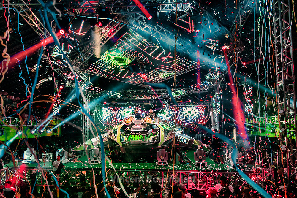 """Launch party for the new Crocodilo Prime - the biggest machine ever (9 meters long) at the Metropoles club, september 2017.  It was built by João do Som, the most respected soundmachine maker.  The Crocodile took a major space in the Tecnobrega scene since 2014. Its DJ's tend to play  the """"pressão"""" style, more funk carioca and raggaton style and less melody than other machines : the croco is one of the favourite  """"aparelhagem"""" of the Youth of Belém,"""