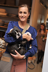 YASMIN LE BON and her pet dog Cecil at a party at Mungo & Maud, 79 Elizabeth Street, London to celebrate the launch of a collection of dog accessories designed by Yasmin Le Bon held on 22nd November 2011.