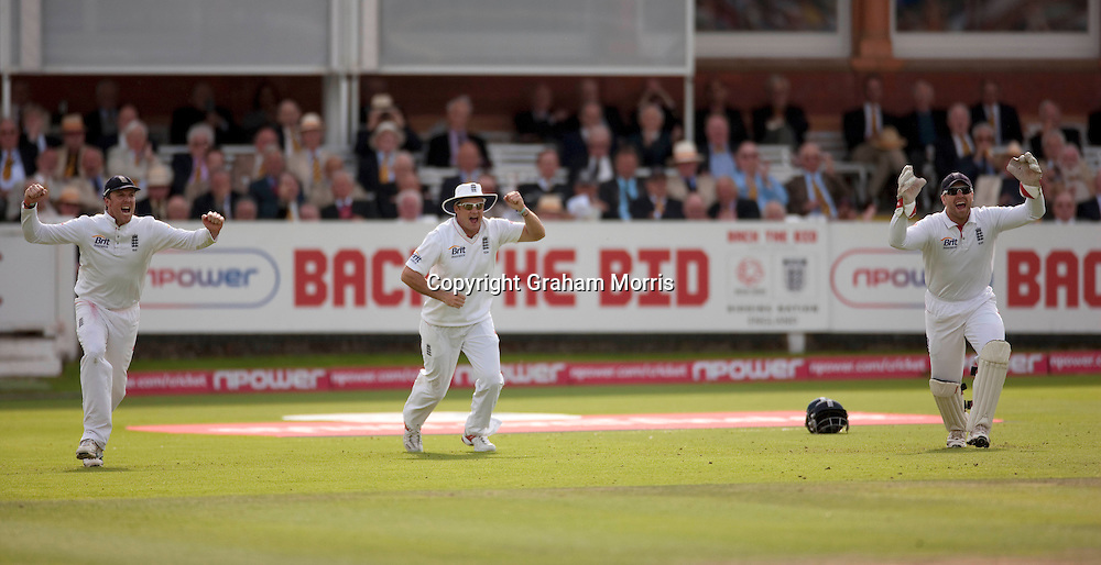 Graeme Swann (left), Andrew Strauss and wicket keeper Matt Prior celebrate as Umar Akmal is bowled by Steven Finn during the final npower Test Match between England and Pakistan at Lord's.  Photo: Graham Morris (Tel: +44(0)20 8969 4192 Email: sales@cricketpix.com) 28/08/10
