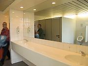 men entering and leaving the male public lavatory