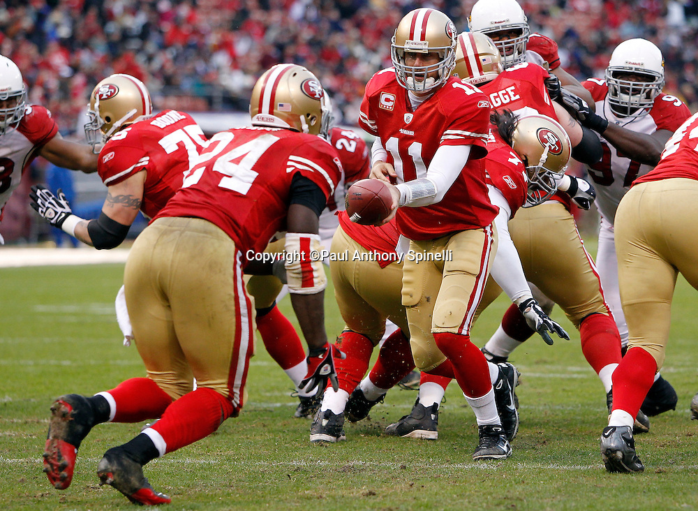 San Francisco 49ers quarterback Alex Smith (11) hands off the ball on a running play to San Francisco 49ers running back Anthony Dixon (24) during the NFL week 17 football game against the Arizona Cardinals on Sunday, January 2, 2011 in San Francisco, California. The 49ers won the game 38-7. (©Paul Anthony Spinelli)
