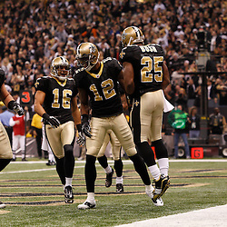 December 12, 2010; New Orleans, LA, USA; New Orleans Saints wide receiver Marques Colston (12) celebrates with teammates after scoring a touchdown in the first quarter against the St. Louis Rams at the Louisiana Superdome. Mandatory Credit: Derick E. Hingle-US PRESSWIRE