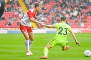 Barnsley Cameron McGeehan (8) passes the ball during the Pre-Season Friendly match between Barnsley and Sheffield United at Oakwell, Barnsley, England on 27 July 2019.