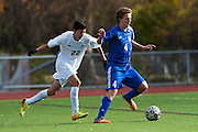Mount Anthony's Andrew Griffin-Leon (4) runs past Burlington's Jonas Lobe (22) with the ball during the quarterfinal boys soccer game between Mount Anthony and Burlington at Buck Hard Field on Friday afternoon October 23, 2015 in Burlington. (BRIAN JENKINS/ for the FREE PRESS)