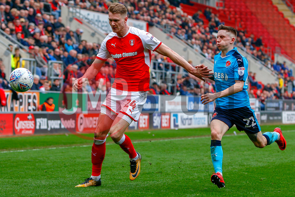 Michael Smith of Rotherham United attempts to hold off Ashley Hunter of Fleetwood Town for possession of the ball - Mandatory by-line: Ryan Crockett/JMP - 07/04/2018 - FOOTBALL - Aesseal New York Stadium - Rotherham, England - Rotherham United v Fleetwood Town - Sky Bet League One