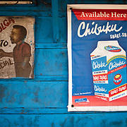 Signs on the wall of a bar, or 'drinking spot' in Agbogbloshie, a slum in Ghana's capital, Accra.
