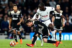 Nicolas Tagliafico of Ajax takes on Moussa Sissoko of Tottenham Hotspur - Mandatory by-line: Robbie Stephenson/JMP - 30/04/2019 - FOOTBALL - Tottenham Hotspur Stadium - London, England - Tottenham Hotspur v Ajax - UEFA Champions League Semi-Final 1st Leg