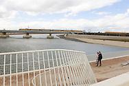 Nederland, Lent, 20160328<br /> Het project Ruimte voor de Waal - het Rivierpark<br /> De nieuwe bruggen naar het eiland op de achtergrond de treinbrug met daraan vast de fietsbrug<br /> Om de bewoners te beschermen tegen hoogwater is de dijk bij Nijmegen-Lent 350 meter landinwaarts gelegd en is een 4 kilometer lange nevengeul gegraven. Door het verleggen van de dijk en het graven van een nevengeul is in hartje stad een langgerekt eiland in de Waal ontstaan.<br /> Het eiland Veur Lent, de Spiegelwaal en de kade Lentse Warande vormen samen een uniek rivierpark, waar ruimte is voor een mix van water en natuur, recreatie en stedelijke activiteiten.<br /> <br /> Netherlands, Lent<br /> Space for the Waal - the River Park<br /> To protect residents against flooding the dike at Nijmegen Lent is 350 meters inland established and dug a 4 kilometer long secondary channel. By shifting the dyke and digging a secondary channel is an elongated island in the Waal River in the heart of the city arose.<br /> The island Veur Lent, the Spiegelwaal and the Waal quay Lentse Cours form a unique river park, with space for a mix of water and nature, recreation and urban activities.