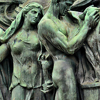 World Telegraph Memorial Detail in Bern, Switzerland <br /> When you walk up on an attractive monument you can take the time to appreciate the craftsmanship of the artist.  An example is this detail of the World Telegraph Memorial by sculptor Giuseppe Romagnoli.  This bronze male and female are on the backside of the fountain closest to the entrance of the Bernisches Historisches Museum in Bern, Switzerland.