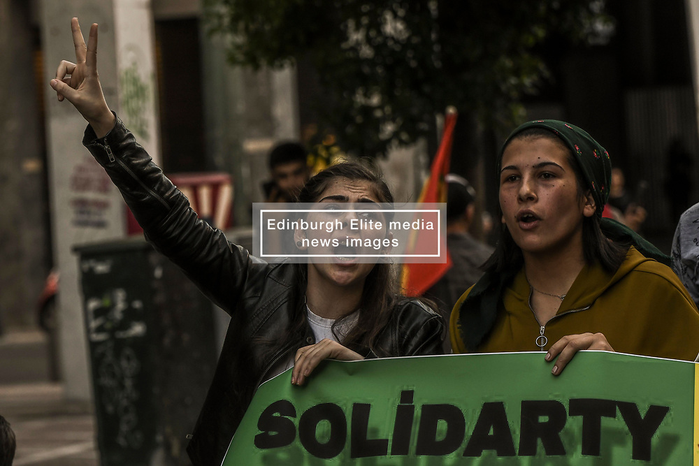 "Kurds living in Greece shout slogans during a protest near the Turkish embassy in Athens, on October 12, 2019. Turkey launched an assault on Kurdish forces in northern Syria with air strikes and explosions reported along the border. President Recep Tayyip Erdogan announced the start of the attack on Twitter, labelling it ""Operation Peace Spring"".<br /> <br /> Pictured: <br /> Dimitris Lampropoulos  