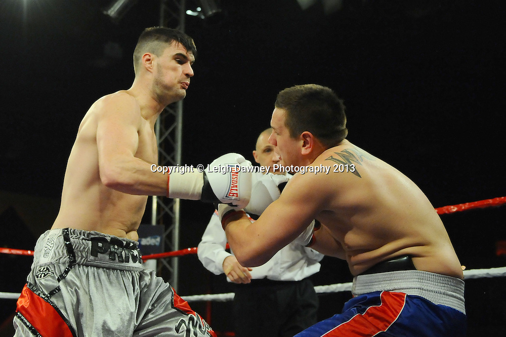 Danny Price (silver shorts) defeats Tamas Bajzath in 6x3 Cruiserweight contest at Rainton Meadows Arena, Houghton Le Spring, Tyne & Wear, UK. 15th February 2013. Frank Maloney Promotions. © Leigh Dawney 2013