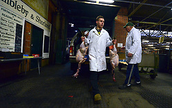 © Licensed to London News Pictures. 21/12/2012. Reading, UK A worker carries turkeys as they arrive for auction. Auction house Thimbleby and Shorland holds its annual traditional christmas poultry sale today 21st December 2012 in Reading, Berkshire. Over 500 lots of fresh turkeys, chickens, geese and duck, all oven ready and rough plucked were available for sale. The general public in the UK are reported  to spend over 300 million GBP on turkey over the Christmas season.. Photo credit : Stephen Simpson/LNP