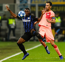 November 7, 2018 - Milan, Italy - Kwadwo Asamoah (L) of Inter Milan and Sergio Busquets of Barcelona vie for the ball during the Group B match of the UEFA Champions League between FC Internazionale and FC Barcelona on November 6, 2018 at San Siro Stadium in Milan, Italy. (Credit Image: © Mike Kireev/NurPhoto via ZUMA Press)